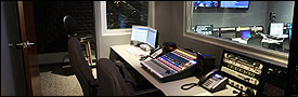 Audio control room with sound booth, phone patch, Skype, and more.