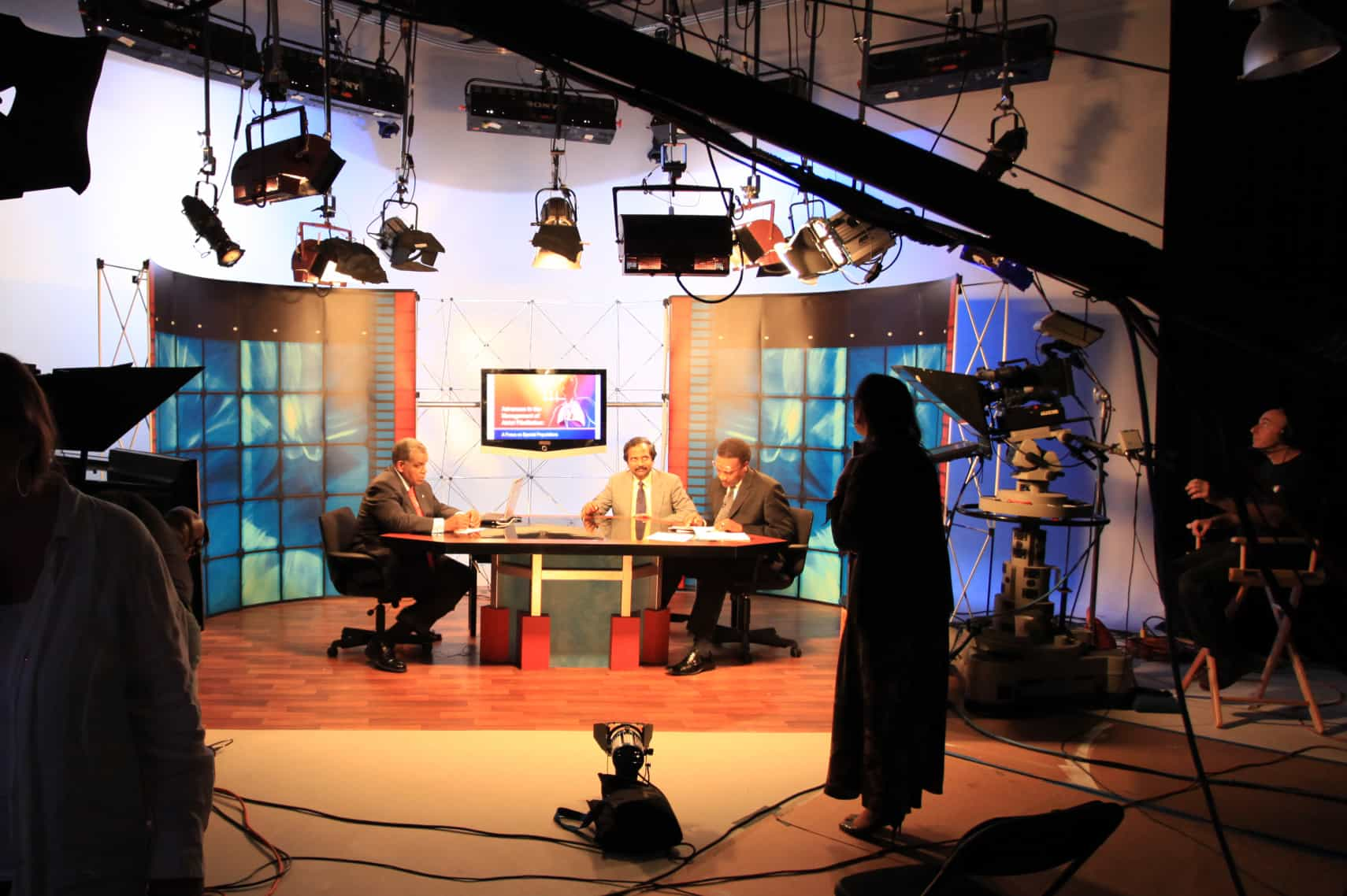Preparing for a live webcast around a round table discussion set in a television studio
